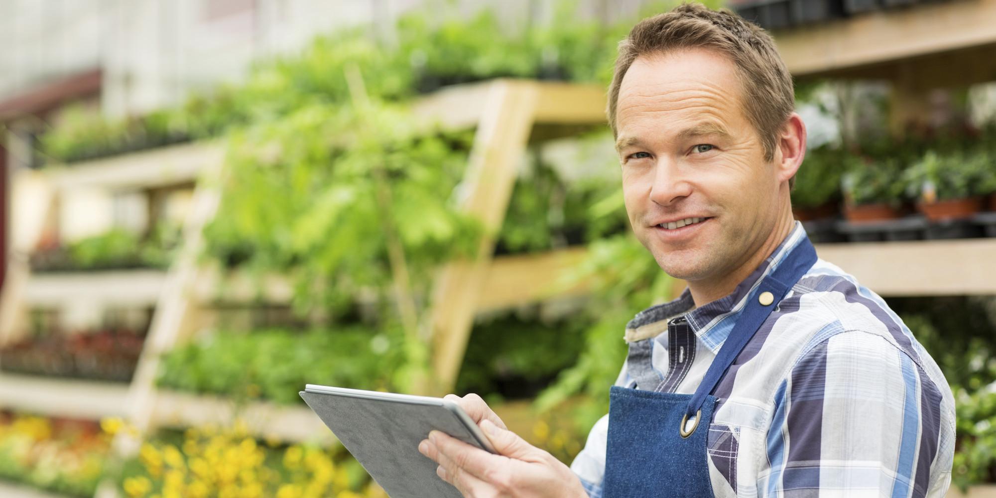 Male Garden Worker Using Digital Tablet
